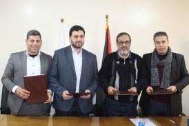 وزارة العمل وشركة توزيع كهرباء محافظات غزة توقعان مذكرة تفاهم